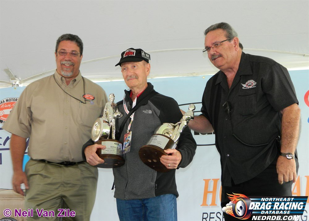 Bernie Shuman accepts NHRA Hall Of Fame trophies for himself and his late brother A.B. in 2013 - 2004 New England Hot Rod Hall Of Fame Inductee