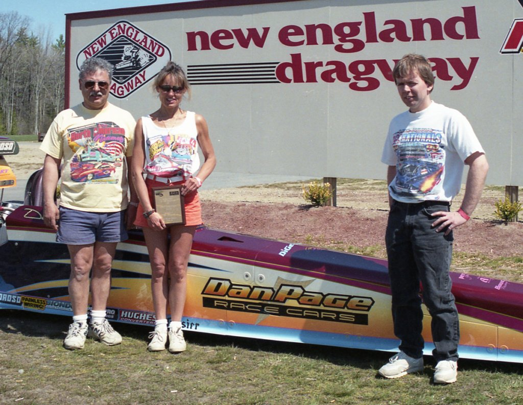 Dan Page joins the DiGenovas in the Winner Circle at the 1999 IHRA Divisional at New England Dragway